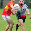 Newmarket's Kevin O'Sullivan about to win possession against Eire Og in the Co. FL Division 2 in Ovens. Picture John Tarrant