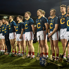 The Cork players stand during the national anthem. Photo by David Maher / SPORTSFILE