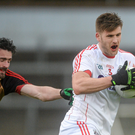 Eoin Cadogan, Cork, in action against Kevin McKernan, Down