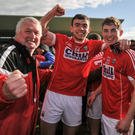 Peter Kelleher and Eoin Lavers, Cork, celebrate with supporters after the game. Photo: Sam Barnes / SPORTSFILE