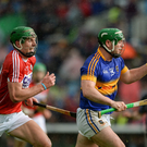 John O'Dwyer of Tipperary in action against Aidan Walsh of Cork during the Munster GAA Hurling Senior Championship Quarter-Final match between Tipperary and Cork at Semple Stadium in Thurles, Co. Tipperary. Photo by Dáire Brennan/SPORTSFILE