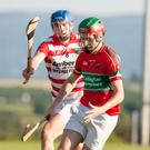 Doneraile's Barry Coffey gathers in the sliotar under pressure from Ballygiblin's Shane Beston during the first half of last weekend's Hibernian Hotel North Cork Junior A Hurling Championship clash in Kildorrery. Photo: Eric Barry/Blink Of An Eye