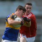 David Butler of Tipperary in action against Diarmuid Colfer of Cork during their Munster GAA Football Junior Championship Semi-Final match between Tipperary and Cork at Semple Stadium