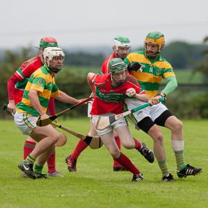 Doneraile's James O'Keeffe battles his way out of defence against Castletownroche in Kildorrery last weekend. Photo by Eric Barry