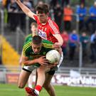 Adrian Spillane, Kerry, and Diarmuid Colfer, Cork, in action during the Munster Junior Football final in Austin Stack Park, Tralee last week. Photo by Domnick Walsh / Eye Focus