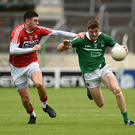 Brian Fanning of Limerick in action against Luke Connolly of Cork during the GAA Football All Ireland Senior Championship Round 2A match between Limerick and Cork at Semple Stadium in Thurles, Tipperary. Photo by Eóin Noonan/Sportsfile