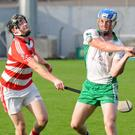 Muskerry's Sean O'Donoghue sets up an attack as Noel McNamara, CIT, tries to challenge in the County Senior Hurling Championship Round 2A at Pairc Ui Rinn. Photo: George Hatchell