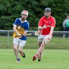 Ballyhooly's Fintan Lenihan plays a short clearance as Kilworth's Michael Wade tries to hook him