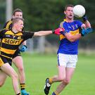 Cullen's Pat O'Sullivan controls the ball from Conor Murphy of Castlemagner