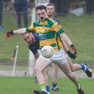 Ballyclough's Damien Buckley shoots for a point as Kilshannig's Liam Casey can only watch on during last weekend's drawn North Cork Junior A Championship semi-final in Buttevant. Photo by Eric Barry