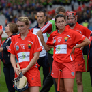 Briege Corkery of Cork, centre, dejected after the Liberty Insurance All-Ireland Senior Camogie Championship Final match between Cork and Kilkenny at Croke Park in Dublin. Photo by Piaras Ó Mídheach/Sportsfile
