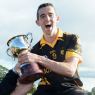 Lismire captain Damien Finn accepts the Duhallow Junior B Football Championship Cup. Photo by John Tarrant