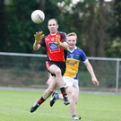 Shanballymore's Kenneth Barry gets ahead of Ballyhooly's Philip Leahy to win possession during the first half of last weekend's North Cork Junior B Football Semi-Final in Castletownroche. Photo by Eric Barry/Blink Of An Eye