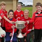 Fourth Class pupils at Kiskeam National School pictured with Cork Ladies All-Ireland winners Shauna Kelly and Deirdre O' Reilly who visited the school with the Brendan Martin Cup. Photo: Sheila Fitzgerald