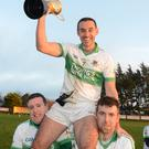 Kanturk captain Daithí O'Connor is shouldered by team mates with the Duhallow JBFL Group 2 Cup. Photo by John Tarrant