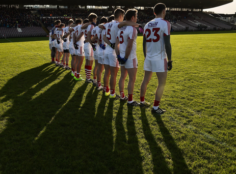 The Cork team stand together during the playing of the national anthem before the start of the Allianz Football League Division 2 Round 1 match between Galway and Cork at Pearse Stadium. Photo by David Maher / Sportsfile