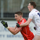 Aidan Walsh of Cork in action against Neil Flynn of Kildare during their NFL Division 2 Round 2 game at St Conleth's Park in Newbridge. Photo by Sportsfile