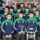 St. Colmans, winners of the Dean Ryan Cup pictured on receiving the monthly Rebel Óg Award at a function in the Clayton Silversprings Hotel, Cork in the company of County Board Chairman, Ger Lane. Photo by John Tarrant