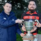 Newmarket captain Kevin O'Sullivan receives the Tom Creedon Memorial Cup from Donal Leahy, PRO Cork Co. Board in the company of Catherine Vaughan. Picture John Tarrant