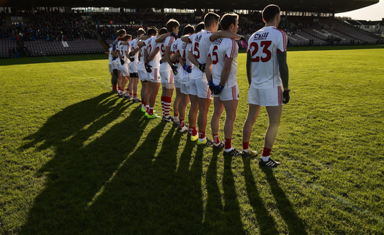 The Cork team stand together during the playing of the national anthem before the start of the Allianz Football League Division 2 Round 1 match between Galway and Cork at Pearse Stadium. Photo by David Maher/Sportsfile