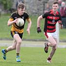 Fermoy's Padraig De Roiste takes on Newmarket's Michael Cottrell during the early stages of last weekend's County Premier Intermediate Football Championship 1st round clash. Photo: Eric Barry