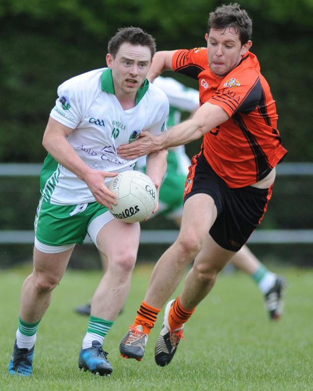 John Corkery (Muskerry) attempts to get away from Bart Daly (Duhallow) during the County SFC in Kanturk