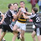 Avondhu's Shane Beston not inclined to release the ball to Kiskeam during the County SFC in Banteer