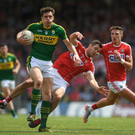 David Moran in action against Jamie O'Sullivan during the Munster SFC Final at Fitzgerald Stadium. Photo by Sportsfile