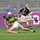 Tim O'Mahony, Newtownshandrum, is brought down in the square by James O'Donovan, Bandon, resulting in a penalty late in the game. Photo by Jim Coughlan