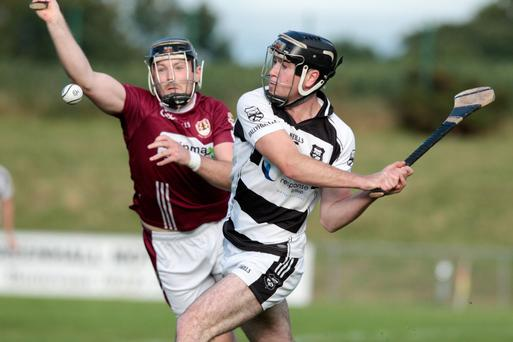 Eugene O'Leary fires over a first half point for Ballyhea during their clash with Bishopstown in the County Senior Hurling Championship last Monday evening. Photo by Eric Barry