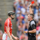 Damien Cahalane of Cork is shown the red card by referee James Owens after picking up a second yellow card during the GAA Hurling All-Ireland Senior Championship Semi-Final match between Cork and Waterford at Croke Park in Dublin. Photo by Piaras Ó Mídheach/Sportsfile
