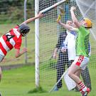 Cian Collins, Charleville Goalkeeper, under pressure under the high ball from Michael O'Donovan, Courcey Rovers in Coachford at the weekend. Photo by Jim Coughlan