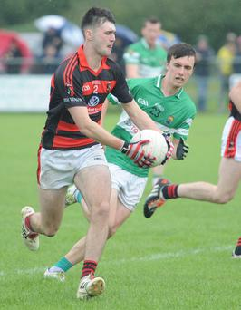 Aidan Browne on the attack for Newmarket against Macroom in the County IFC quarter final at Dromtariffe