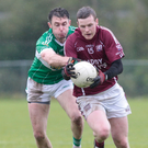 Rockchapel's William Murphy holds on to the ball as he gets challenged by Aghabullogue's David Moynihan during last weekend's County Intermediate Football Championship Replay in Mourneabbey. Photo by Eric Barry