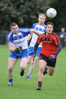 Mitchelstown's Greg Carroll and Cill na Martra's Noel O'Leary seek out the ball in the County IFC semi-final. Photo by John Tarrant