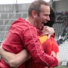 Mallow manager Keith Moynihan celebrates with Denis Hayes after last weekend's dramatic win over St. Michaels in the County Premier Intermediate Football Championship Final at Pairc Ui Chaoimh. Photo by Eric Barry