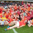 Mallow players and coaches celebrate promotion to senior football after winning last Sunday's Premier Intermediate Football Championship Final over St. Michaels at Pairc Ui Chaoimh. Photo by Eric Barry
