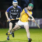 Kilshannig's Conor Murphy gets his pass away before Sarsfields' Roy Egan can get a block in during last weekend's County U21B Hurling Championship Final