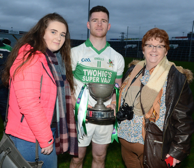Kanturk captain Lorcan O'Neill pictured with mum Geraldine and Katie Feehan after winning the Munster Club IHC title. Picture John Tarrant