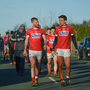 Cork's Ruairi Deane, left, and Mark Collins make their way to the changing room at half time of the McGrath Cup match between Waterford and Cork at The Gold Coast Resort in Waterford. Photo by Sportsfile