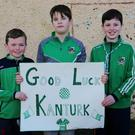Eyes on the prize: Dara Browne, Callum Marwood and Ronan Harrington supporting the Kanturk team at St. Colman's National School
