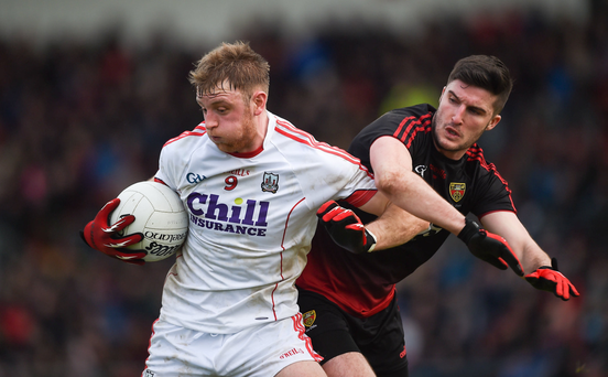 Cillian O'Hanlon of Cork in action against Niall McParland of Down during the Football League match at Páirc Esler in Newry