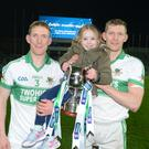 Caoimhe McLoughlin delighted with her dad Lorcán and uncle John after Kanturk's victory in Croke Park. Photo by John Tarrant