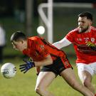 Duhallow's Anthony O'Connor gets in front of Seandun's Shane Duggan to try win possession during the County Senior Football Championship clash in Mallow on Tuesday night. Photo by Eric Barry