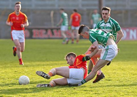 Kevin Sheehan, Mallow and Aaron Lyons and Jack Walsh, Valley Rovers in action during their round 1 clash in Pairc Uí Rinn on Saturday evening. Photo by Jim Coughlan