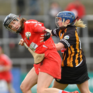 Pamela Mackey of Cork in action against Kilkenny's Meighan Farrell, left, and Michelle Quilty during the Littlewoods Ireland Camogie League Division 1 Final match between Kilkenny and Cork at Nowlan Park in Kilkenny. Photo by Piaras Ó Mídheach/Sportsfile