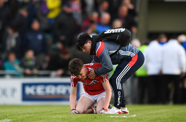 David Buckley of Cork is consoled by a supporter following the Electric Ireland Munster GAA Football Minor Championship semi-final match between Kerry and Cork at Austin Stack Park, in Tralee, Kerry. Photo by Eoin Noonan/Sportsfile