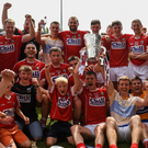 Cork players celebrate with the cup following the Munster GAA Hurling Senior Championship Final match between Cork and Clare at Semple Stadium. Photo: Sportsfile