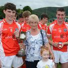 Cork West captain Shane Kingston accepts the Humphrey Kelleher Memorial Cup from Mai Kelleher in the presence of Tim McCarthy, Gearóid Ó Ealaithe and Anna Mai Dundon following a win over Kerry North in Millstreet. Photo by John Tarrant