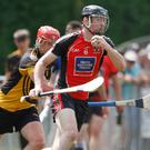 Shanballymore's Sean Lynch gathers possession under pressure from Fermoy's Pa Boyce during last weekend's JAHC clash between the sides in Glanworth. Photo by Eric Barry